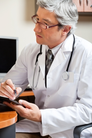 Mature Male Doctor In Clinic photo