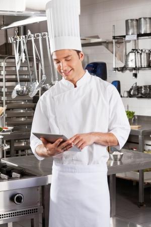 hotel staff: Male Chef Using Digital