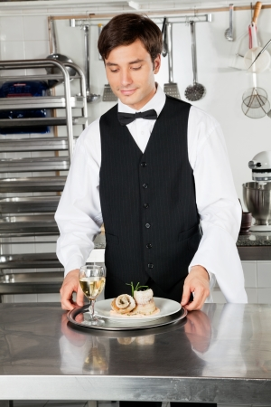 Waiter With Salmon Roll And White Wine photo