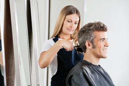 beauty parlor: Female Hairdresser Cutting Client s Hair