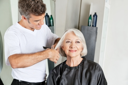 Hairdresser Cutting Senior Client s Hair photo