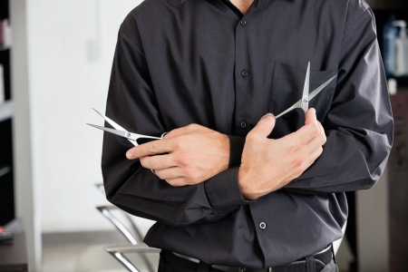 Male Hairstylist Holding Two Scissors Stock Photo - 18137383
