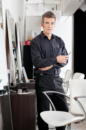 Confident Male Hairdresser With Scissors At Salon Stock Photo - 18136836
