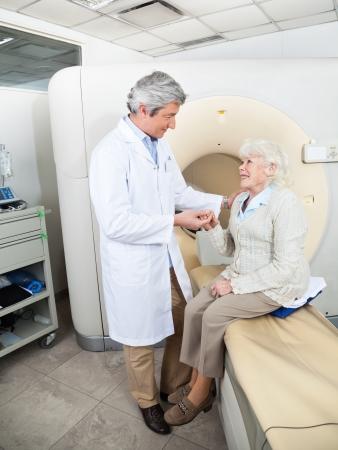x ray equipment: Doctor Comforting Senior Patient Stock Photo