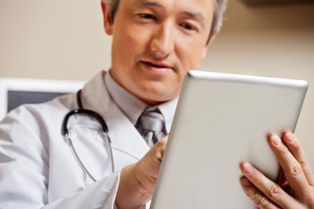 Doctor Using Digital Tablet photo