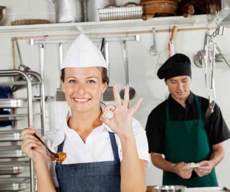 Happy Female Chef Gesturing Okay Sign photo