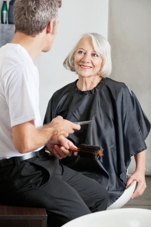 Customer And Hairstylist Having Conversation photo