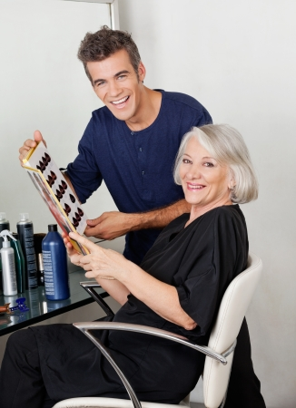 Hairstylist And Client With Color Catalog photo