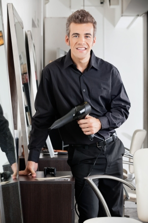 Happy Male Hairdresser With Hairdryer Stock Photo - 20591877