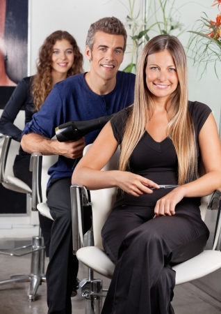 Confident Team Of Hairdressers At Salon photo