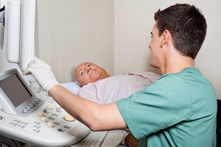 Patient Looking At Ultrasound Machine s Screen Stock Photo - 18236530