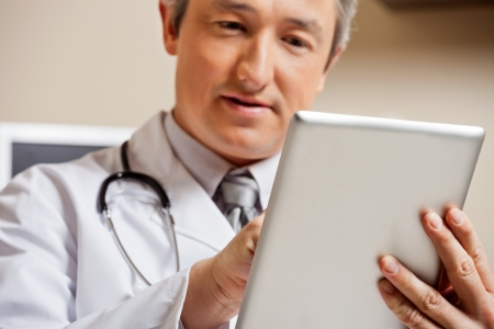 medical record: Doctor Using Digital Tablet
