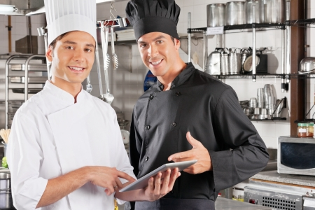Happy Chefs Holding Digital Tablet photo
