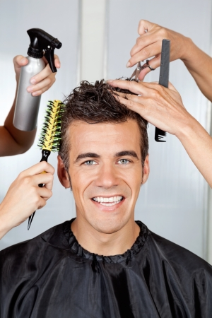 Client With Hairdressers Styling His Hair Stock Photo - 18236578