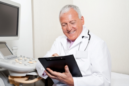 Radiologist Holding Clipboard Stock Photo - 18261146