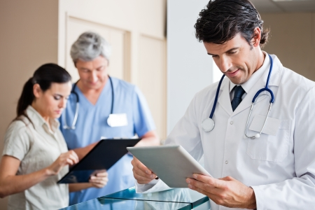 patient: Male Doctor Holding Digital Tablet