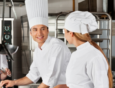 Male Chef With Colleague At Kitchen Stock Photo - 18261119