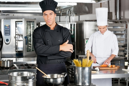 Confident Chef With Colleague In Kitchen photo