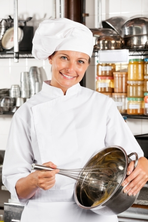 Happy Chef Mixing Egg With Wire Whisk Stock Photo - 18261992