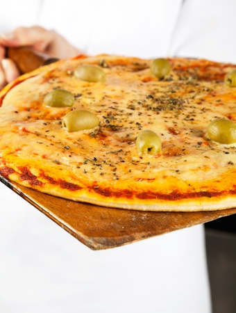 Closeup Of Pizza On Shovel Stock Photo - 18261112