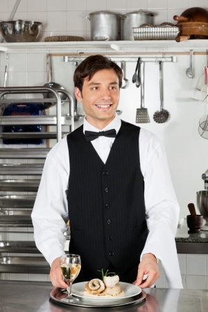 Waiter With Salmon Roll And White Wine Stock Photo - 18261248