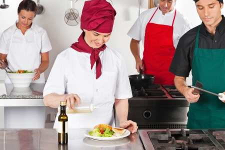Chefs Working In Kitchen Stock Photo - 18261272