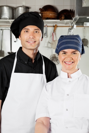 Happy Chefs In Industrial Kitchen Stock Photo - 18261980