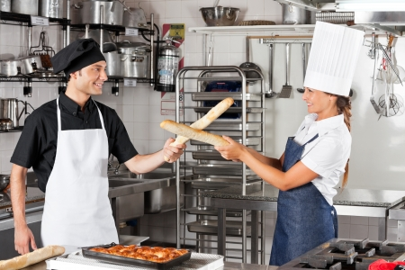 Chefs Fighting With Bread Loafs Stock Photo - 18262089