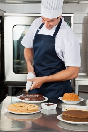 Chef decorating sweet food with piping bag Stock Photo - 18261889