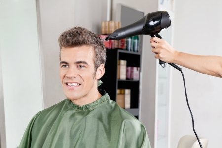 Client Gets His Hair Dried In Salon Stock Photo - 18261758