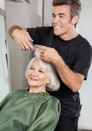 Hairstylist Cutting Client s Hair In Parlor Stock Photo - 18262024