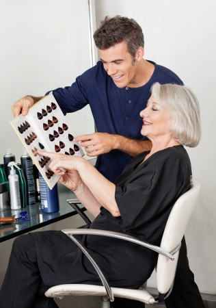 Client And Hairdresser Selecting Hair Color From Catalog Stock Photo - 18261788