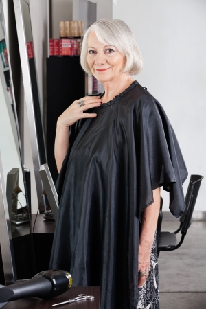 Senior Female Customer Standing At Salon photo