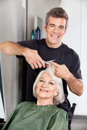 Hairdresser Cutting Client s Hair At Salon Stock Photo - 18262037