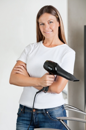 Confident Hairstylist With Hairdryer In Parlor Stock Photo - 18262023