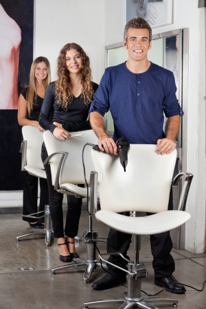 Hairdressers Standing In Salon photo