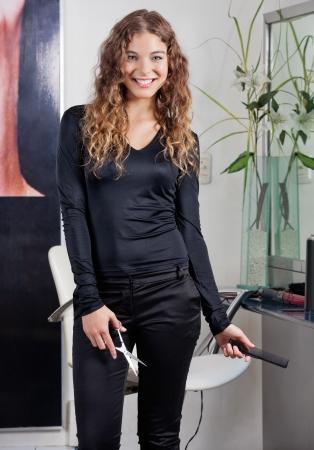 straightener: Female Hairdresser Holding Scissors And Straightener