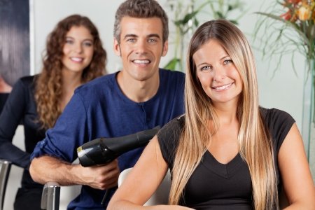 Team Of Hairdressers At Beauty Parlor photo