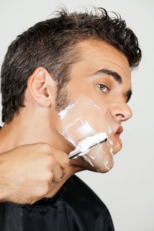 straight razor: Mature Man Shaving His Face