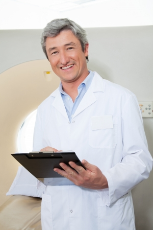 Happy Doctor Holding Clipboard Stock Photo - 18291701