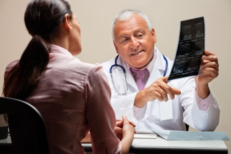 Radiologist Explaining X-ray To Patient photo