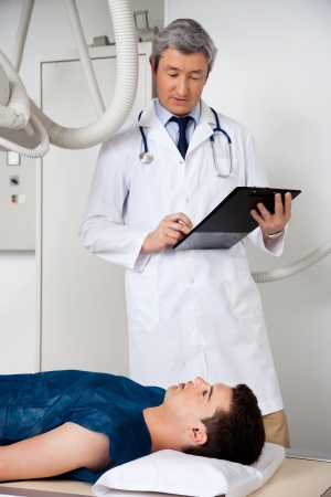 Radiologist With Patient At Clinic photo