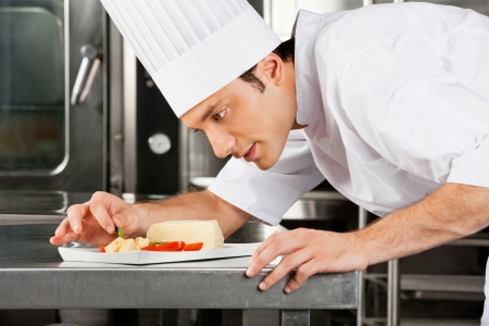 garnishing: Chef Garnishing Dish