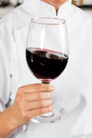 Chef Holding Glass Of Red Wine photo