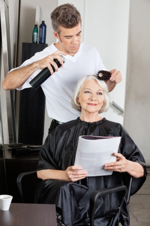 Woman Getting Her Hair Done In Salon photo