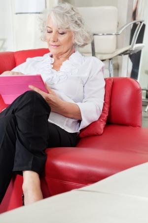 Client Using Digital Tablet At Salon photo