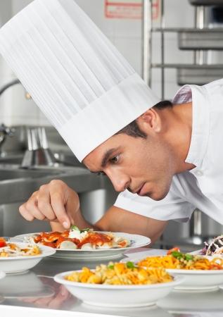 garnishing: Chef Garnishing Pasta Dishes