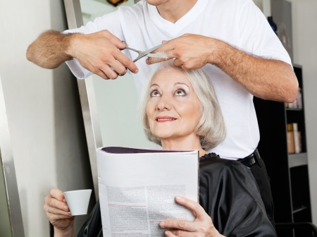 Senior Woman Having Haircut At Salon photo