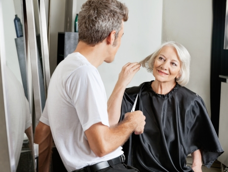 beauty parlor: Client Instructing Hairdresser In Salon