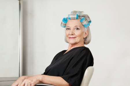 Female Client With Hair Curlers At Salon photo